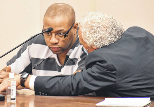 Kirk McVay from the Ohio Public Defenders Office confers with Timothy Youngblood after the Lima man was sentenced Monday to 15 years to life in prison for murdering his father more than two years ago.