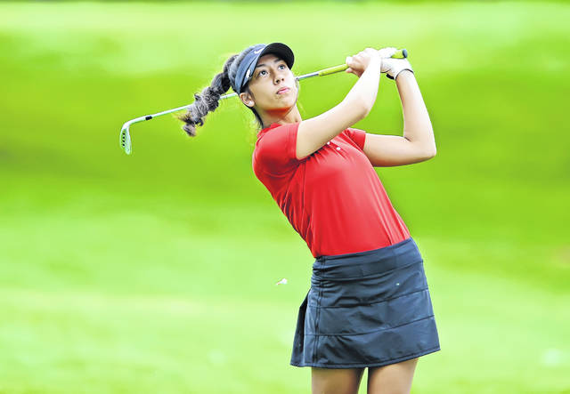 Shawnees Madilyn Paphanchith watches her shot from the 13th tee during Tuesday's Colonial Golfers Club Girls Golf Tournament in Harrod.