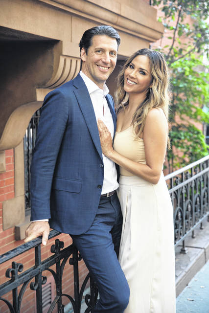 Realtor Gordon von Broock, left, and hair colorist Alix Mane pose for a portrait in New York on July 12, 2020. The couple, who are now engaged, had their first Zoom date at the end of April. It lasted seven hours.