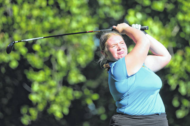 Lydia Werts of Delphos St. John's watches her tee shot during Wednesday's Allen County Girls High School Golf Tournament at Springbrook Golf Club.