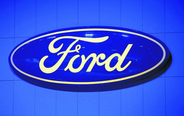 FILE - This Thursday, Nov. 29, 2012, file photo, shows the company's logo at the LA Auto Show in Los Angeles. The U.S. government is investigating complaints that the brakes can fail on Fords F-150 pickup truck. (AP Photo/Jae C. Hong, File)