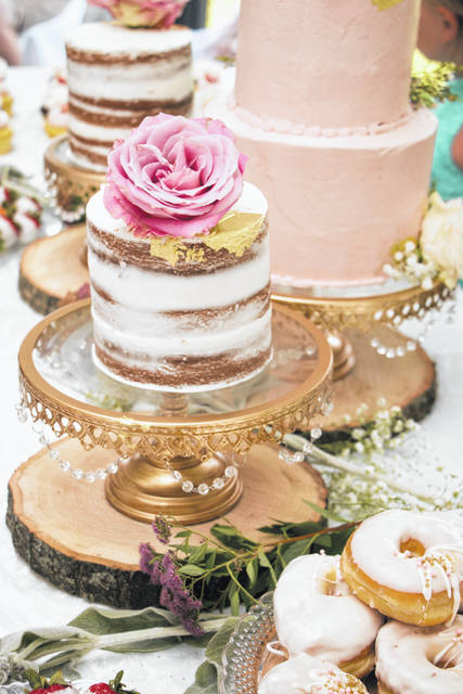 Touches of gold leaf decorate a wedding cake.