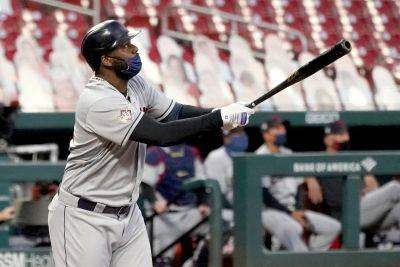 Cleveland Indians' Franmil Reyes watches his three-run home run during the first inning of Friday night's game against the Cardinals in St. Louis. (AP photo)
