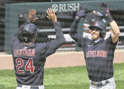 Cleveland's Jordan Luplow, right, celebrates with Domingo Santana after hitting a home run during Saturday's game against the White Sox in Chicago.