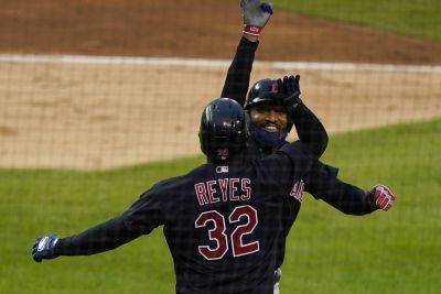 Cleveland's Domingo Santana is greeted by Franmil Reyes after hitting a home run during Friday night's game against the Tigers in Detroit. (AP photo)