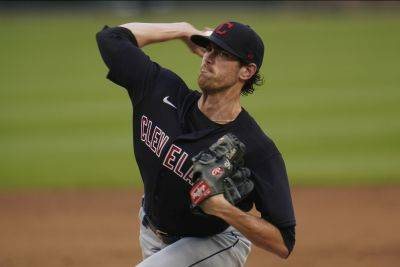Cleveland's Shane Bieber allowed three hits and a walk and lowered his ERA to 1.30 in Saturday night's win against the Tigers in Detroit. (AP photo)