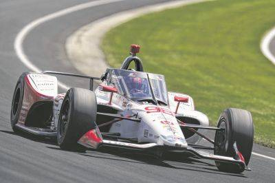 Marco Andretti drives through the third turn during Saturday qualifying for the Indianapolis 500 at Indianapolis Motor Speedway in Indianapolis.