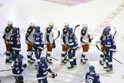 Columbus Blue Jackets and Tampa Bay Lightning players shake hands Wednesday following Game 5 of their Eastern Conference Stanley Cup first round playoff series in Toronto. (AP photo)