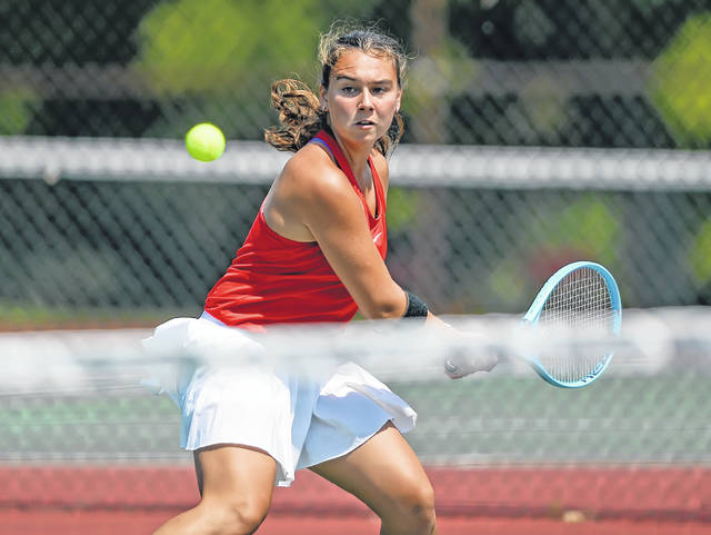 Wapakoneta's Madison Snider hits a backhand during Saturday's Lima Invitational at Collett Street courts.