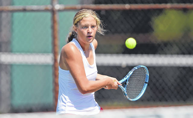 Lima Central Catholic's Morgan Chaney hits a backhand during Saturday's Lima Invitational at Collett Street courts.