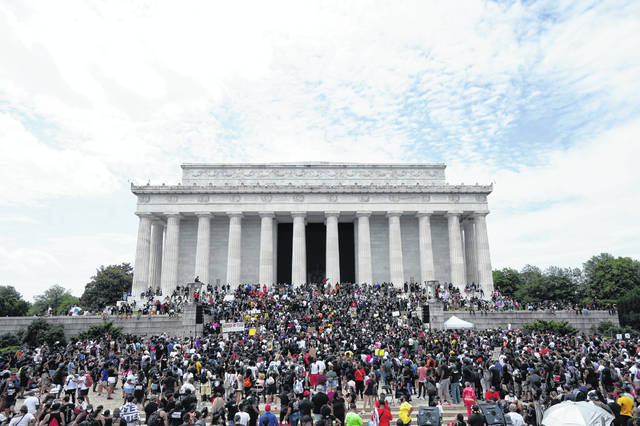 People prepare march from the Lincoln Memorial to the Martin Luther King Jr. Memorial during the March on Washington, Friday Aug. 28, 2020, in Washington.