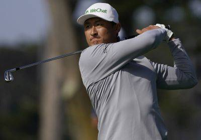 Li Haotong hits from the fairway on the 10th hole during Friday's second round of the PGA Championship at TPC Harding Park in San Francisco. (AP photo)