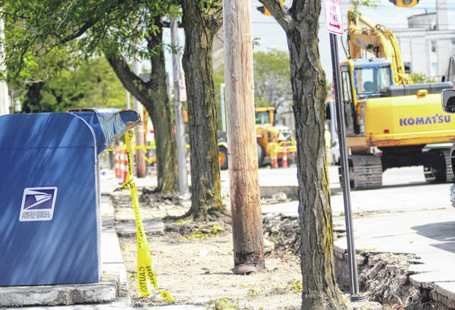 The post office box on High Street has been pulled from the sidewalk as part of the City of Lima's ALL-LIMA project. City Engineer Kirk Niemeyer said it will be replaced during the reconstruction of the area.