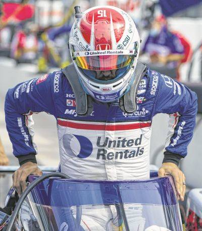Graham Rahal climbs into his car during Friday practice for the Indianapolis 500 at Indianapolis Motor Speedway in Indianapolis.