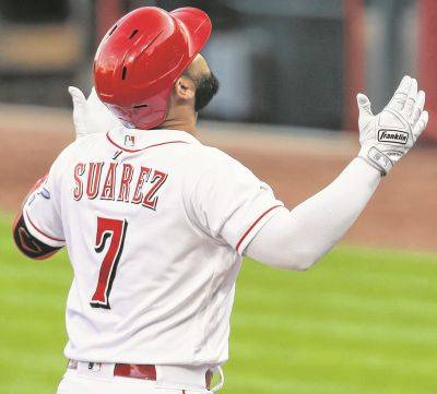 The Reds' Eugenio Suarez celebrates hitting a solo home run during Tuesday night's game against Cleveland in Cincinnati.