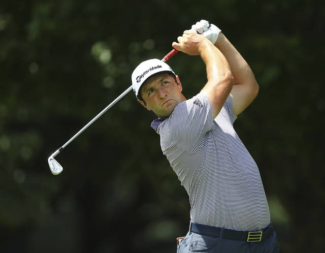 Jon Rahm, ranked second behind Dustin Johnson in FedEx Cup points, tees off on the par-3 11th hole during his practice round for the season-ending Tour Championship at East Lake Golf Club on Wednesday, Sept. 2, 2020, in Atlanta. (Curtis Compton/Atlanta Journal-Constitution via AP)