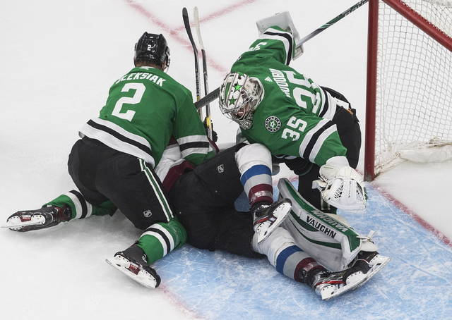 Dallas Stars' goaltender Anton Khudobin (35) is crashed into by Colorado Avalanche right wing Mikko Rantanen (96) and Stars defenceman Jamie Oleksiak (2) during the first period NHL of a Western Conference Stanley Cup playoff game in Edmonton, Alberta, on Wednesday, Sept. 2, 2020. (Jason Franson/The Canadian Press via AP)