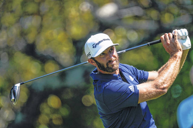 Dustin Johnson hits his tee shot on the fifth hole during the final round of the Tour Championship golf tournament at East Lake Golf Club in Atlanta, Monday, Sept. 7, 2020. (AP Photo/John Bazemore)