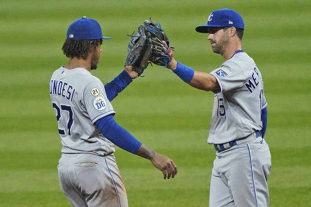 Kansas City Royals' Adalberto Mondesi, left, and Whit Merrifield celebrate after the Royals defeated the Cleveland Indians 3-0 in a baseball game Wednesday, Sept. 9, 2020, in Cleveland. (AP Photo/Tony Dejak)