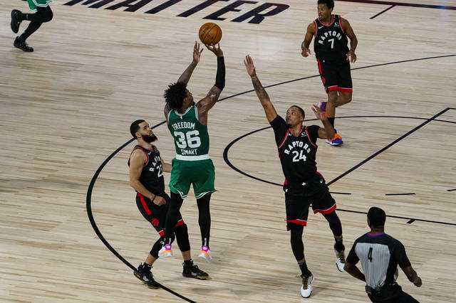 Boston Celtics guard Marcus Smart (36 misses a shot over over Toronto Raptors guard Norman Powell (24) with less a second remaining in the second overtime an NBA conference semifinal playoff basketball game Wednesday, Sept. 9, 2020, in Lake Buena Vista, Fla. (AP Photo/Mark J. Terrill)