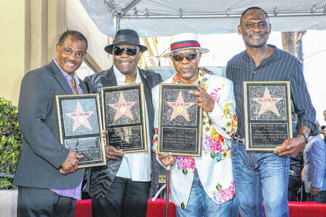 """Robert """"Kool"""" Bell, from left, Ronald """"Khalis"""" Bell, Dennis """"DT"""" Thomas and George Brown attend a ceremony honoring Kool & The Gang with a star on The Hollywood Walk of Fame on Oct. 8, 2015, in Los Angeles. Ronald """"Khalis"""" Bell, a co-founder and singer in the group, died at the age of 68."""