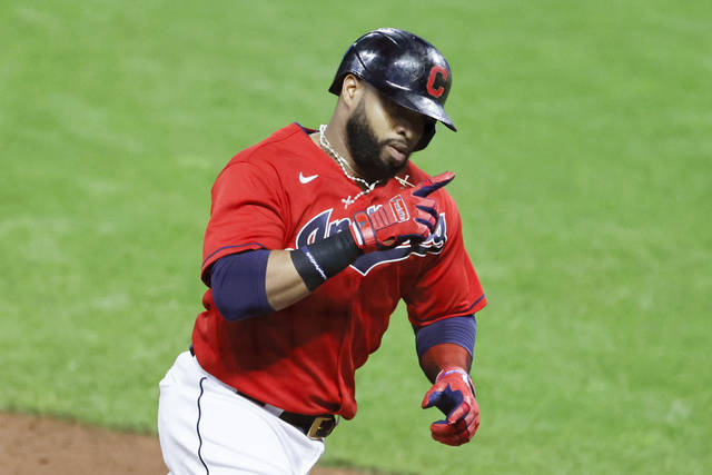 Cleveland Indians' Carlos Santana rounds the bases after hitting a two-run home run off Chicago White Sox pitcher Jace Fry during the fifth inning of a baseball game, Monday, Sept. 21, 2020, in Cleveland. (AP Photo/Ron Schwane)