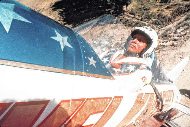 "In this Sept. 8, 1974, photo, Evel Knievel sits in the steam-powered rocket motorcycle that will hopefully take him across Snake River Canyon in Twin Falls, Idaho. Evel Knievel's son is on a collision course with the Walt Disney Co. and Pixar over a movie daredevil character named Duke Caboom. A federal trademark infringement lawsuit filed Tuesday Las Vegas accuses the moviemaker of improperly basing the ""Toy Story 4"" character on Knievel."