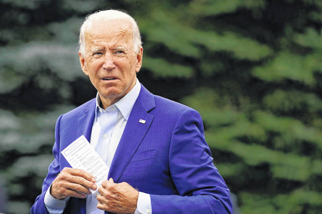 Democratic presidential candidate former Vice President Joe Biden places a note card in his jacket pocket as he speaks at a campaign event on manufacturing and buying American-made products at UAW Region 1 headquarters in Warren, Mich., Wednesday, Sept. 9, 2020.