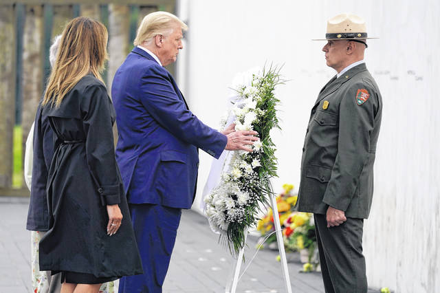 President Donald Trump lays a wreath at a 19th anniversary observance of the Sept. 11 terror attacks, at the Flight 93 National Memorial in Shanksville, Pa., Friday, Sept. 11, 2020.