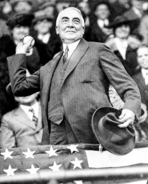 FILE - In this April 13, 1921, file photo, President Warren G. Harding throws out the first ball to open the Washington Senators' baseball season. The grandson of U.S. President Warren G. Harding has gone to court seeking to dig up the Republican's remains from the presidential memorial where they have lain since 1927.