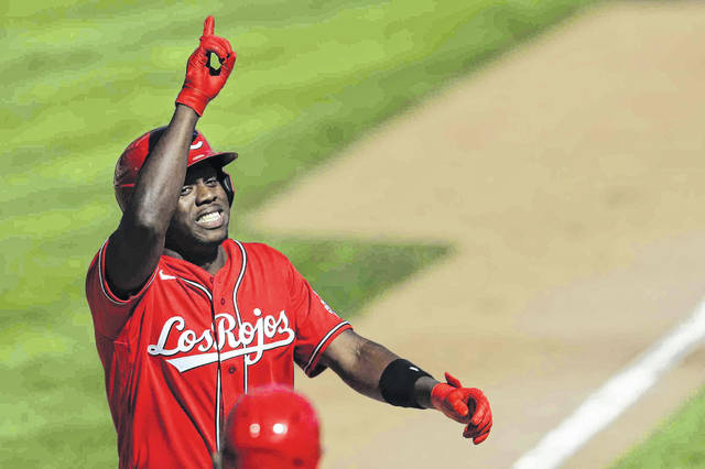 Cincinnati Reds outfielder Aristides Aquino celebrates after hitting a long two-run home run in the fifth inning of the Reds' 7-3 win over the Chicago White Sox on Sunday in Cincinnati.