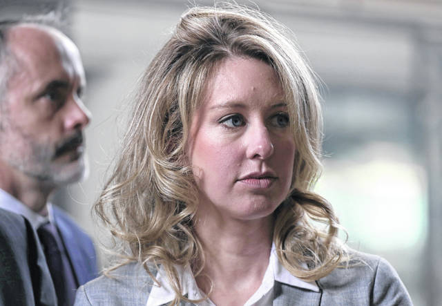 In this file photo, former Theranos founder and CEO Elizabeth Holmes arrives at the Robert F. Peckham U.S. Federal Court on June 28, 2019, in San Jose, Calif. Holmes was charged with conspiracy and wire fraud for allegedly engaging in a multimillion-dollar scheme to defraud investors with the Theranos blood-testing lab services.