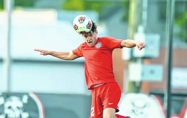 Bluffton's Josh Mehaffie heads the ball against Spencerville during Monday's match at Steinmetz Field in Bluffton. The Pirates improve to 3-0 after the 10-o win. See more match photos at LimaScores.com.