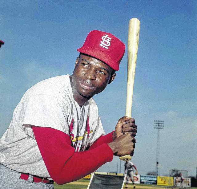 Lou Brock, a Hall of Fame outfielder the the National League record holder for most stolen bases, is shown here in a 1965 file photo.