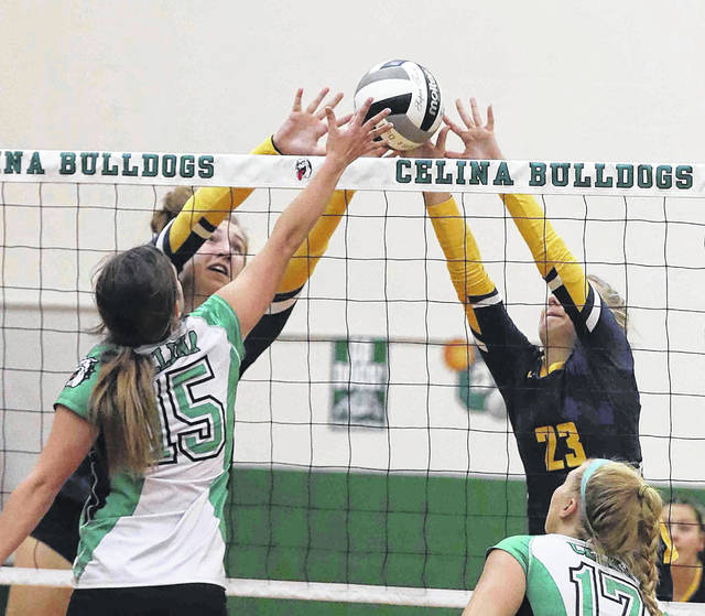Ottawa-Glandorf 's Erin Kaufman, left, and Miya Ellerbrock (23) battle Celina's Brooklyn Bourne (15) above the net during Thursday night's match in Celina. See more match photos at LimaScores.com.