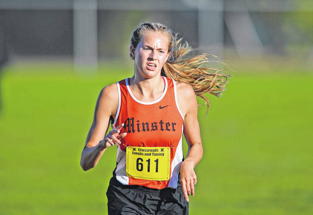 Minster's Ella Boate competes in Saturday's Columbus Grove Invitational. See more invitational photos at LimaScores.com.