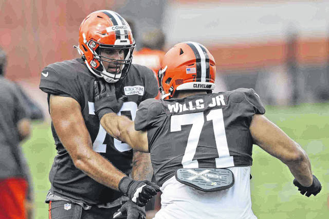 Cleveland Browns offensive tackles Jedrick Wills Jr., a first-round draft pick, and Jack Conklin, a much sought after free agent, work on a drill during practice at the NFL football team's training camp facility.