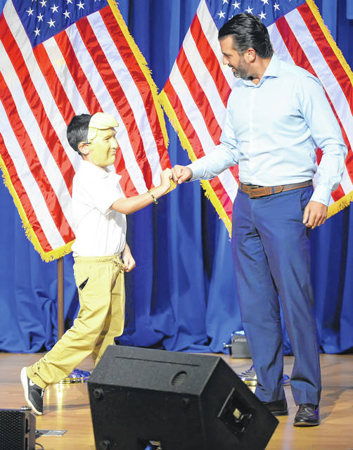 "Donald Trump Jr. speaks to Pablo Ertel, 9, during a ""Make America Great Again"" campaign rally at the UNOH Event Center on Wednesday. See more photos of the event at limaohio.com."