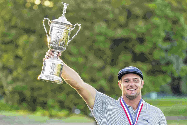Bryson DeChambeau, of the United States, holds up the winner's trophy after hissix-shot victory in the US Open Golf Championship on Sunday at Winged Foot Golf Club in Mamaroneck, N.Y.