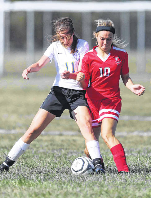Continential's Bryn Tegenkamp (11) tries to gets the ball away from Delphos Jefferson's Alyvia Lindeman during Saturday's match at Delphos Jefferson. See more match photos at LimaScores.com.