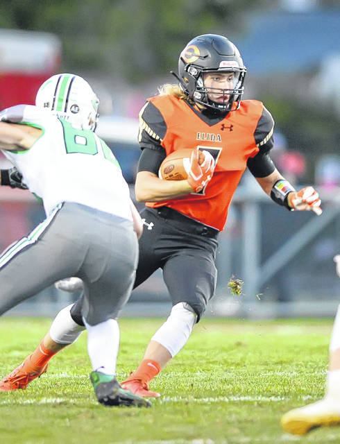 Elida's Andrew Etzkorn looks to get past Celina's Quade Gilmore during Friday night's game at Elida.