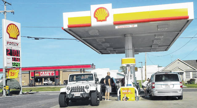 Drivers pump gas into their vehicles at the Ottawa Party Mart, 746 N. Perry St., Ottawa, on Thursday afternoon. The Shell station and the nearby Casey's station both had regular gasoline advertised for $2.159 per gallon.