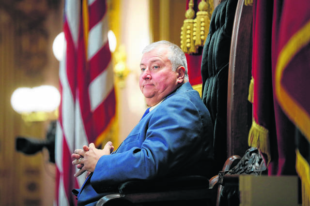 FILE - In this Wednesday, Oct. 30, 2019, file photo, Republican Ohio state Rep. Larry Householder, of District 72, sits at the head of a legislative session as Speaker of the House, in Columbus.