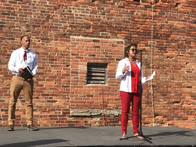 Tracie Sanchez, right, and Jerome O'Neal unveil plans for the Central District, a repurposed block of Lima's Central Avenue that organizers hope will become a destination for Lima's young adults and others.