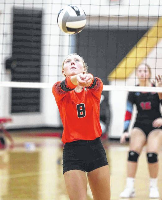 Elida's Cadence Miller keeps the ball alive during Saturday's match at Lima Central Catholic.