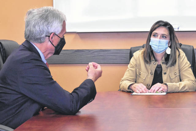 Bob Latta, who represents Ohio's 5th Congressional District, talks with Jennifer Smith, director of the Family Health Care agency in Van Wert, during a visit Friday morning.