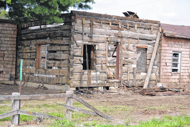 A log cabin was found underneath the shingles of this home at 1499 N. Conant Road in Allen County. The cabin is headed to Indiana where it will be repurposed for the new owner's family.