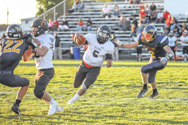 Elida's Larkin Henderson finds room to run during Friday night's Western Buckeye League game at Ottawa-Glandorf.