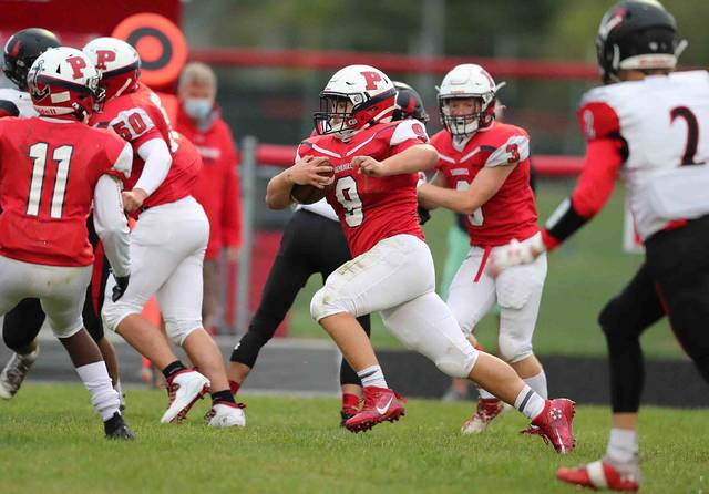 Perry's J.T. Taviano gains yardage during Friday night's North Central Conference game against Upper Scioto Valley at Perry.