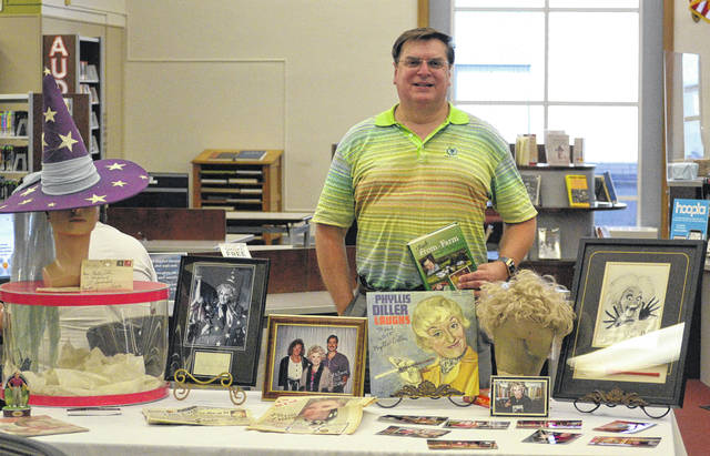 Author Phil Potempa brought out some of his Phyllis Diller memorabilia at the Lima Public Library on Saturday. Diller has collaborated with Potempa on several recipe books.